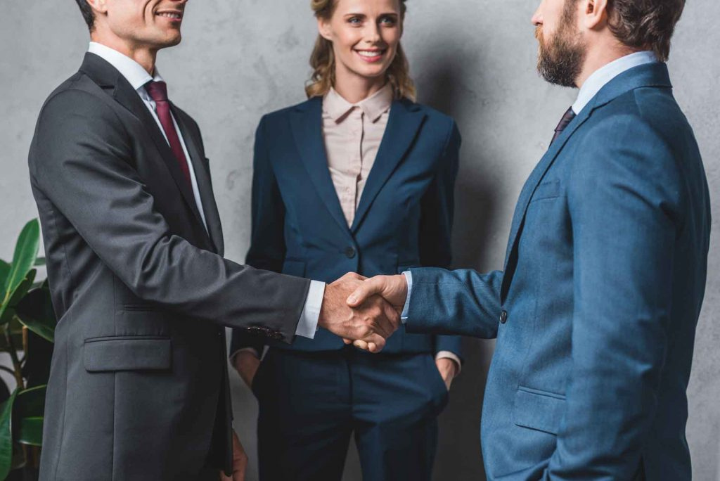 Grape Law Firm PLLC Page, Partial View of Business People Shaking Hands